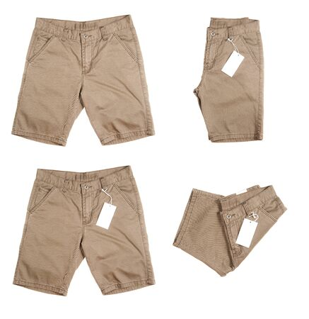 khaki pants: Trousers with tagging on white background