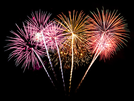 Colorful fireworks on the black sky background Stock Photo
