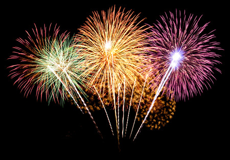 Colorful fireworks on the black sky background Standard-Bild
