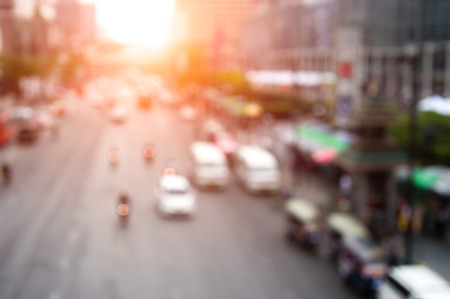 Abstract urban background with blurred buildings and street, shallow depth of focus photo