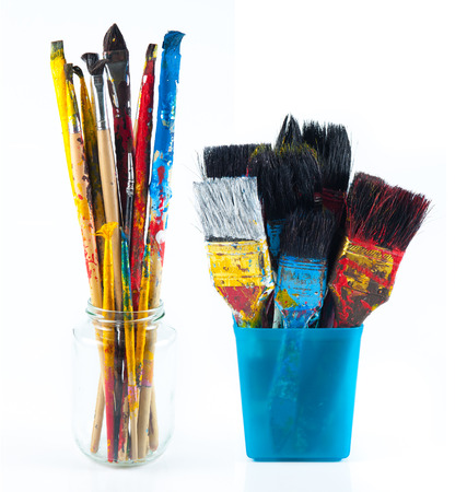 paintbrushes: Used artist paintbrushes in a jar.