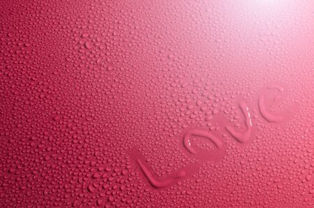 Valentine Day Love heart made by water bubbles on a red background photo