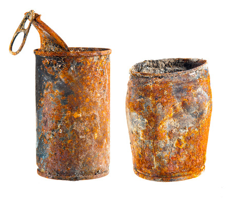 Old rusty tin can on white background photo