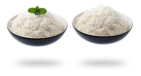 bowl full of rice with mint on white background photo