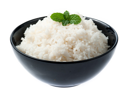 bowl full of rice with mint on white background