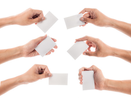 business card in hand: Hands hold business cards on white background