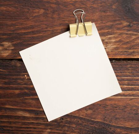 clip and note paper  on wood