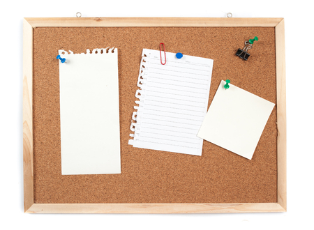 posted: Cork board with several blank notes with pins on white background