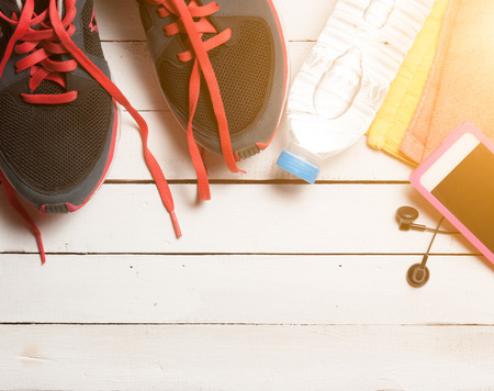 sports activities: Set for sports activities on white wooden background,morning light Stock Photo