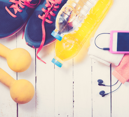 sports activities: Set for sports activities on white wooden background,vintage color toned image Stock Photo