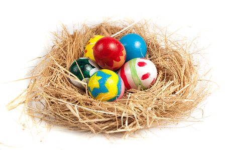 Colorful Easter eggs in nest from hay photo