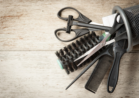 scissors comb: hairdresser tools on white wood