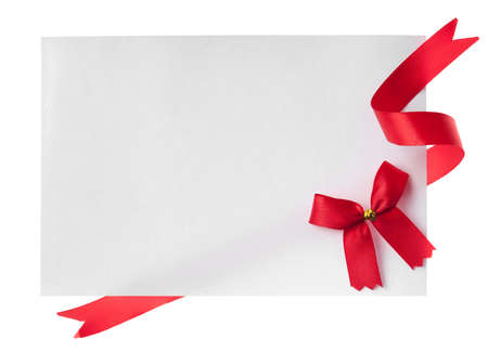 red label: Shiny red ribbon with card isolated on white
