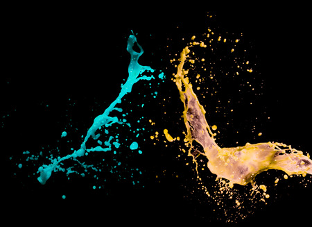 Colorful paint splashing on black background