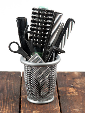 coiffeur: outils de coiffeur sur bois