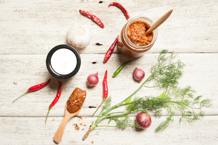 thai chili pepper: thai kitchen food spice herb pepper, grass, red onion, garlic, chilli, ginger for cooking original eastern food syle on wood Stock Photo