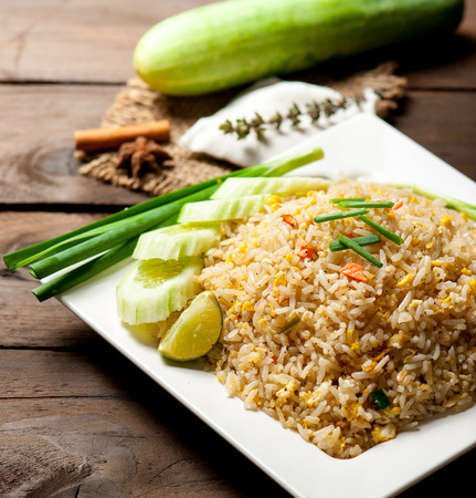 fried egg: Fried Rice Thailand style and Vegetables on wood table Stock Photo