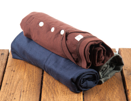 polo t shirt: Rolled T Shirts on wood background