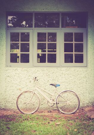 old bicycle: Vintage bike against wall,vintage tone style Stock Photo