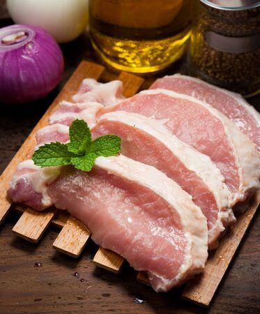 Meat, pork, slices pork loin on wood Stock Photo