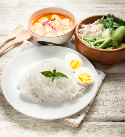 vermicelli: Thai rice vermicelli on wooden table Stock Photo