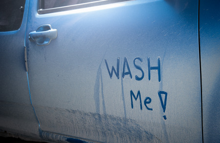 Wash me - dirty car Stock Photo