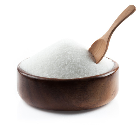 wooden spoon: White sugar in wood bowl on white background