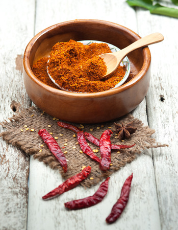 Cayenne pepper spice on wooden table