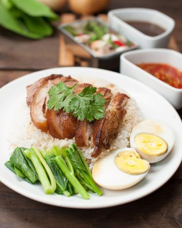 stewed: Thai stewed pork leg with rice on wood(Kao Kha Moo)