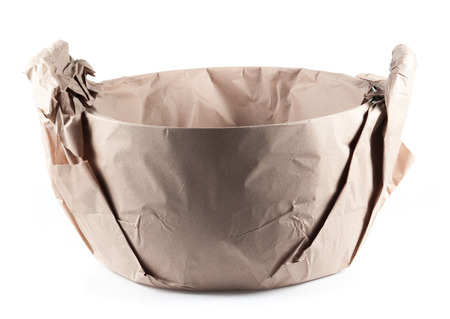 removals: steel pot wrapped in brown paper on white background