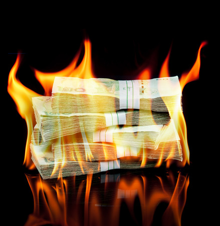 Thai money bill on fire with black background