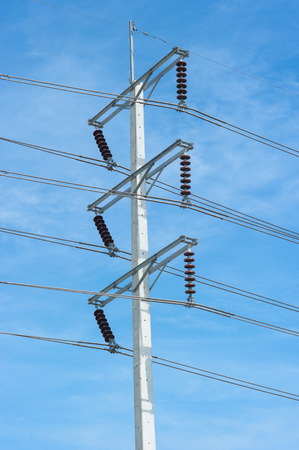 unorganized: electricity post in blue sky at Thailand Stock Photo