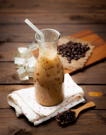 cold beverages: Glass Of Cold Coffee on wood