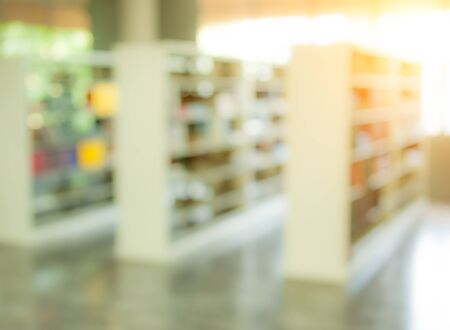 books on bookshelf in library, abstract blur defocused background Stock Photo