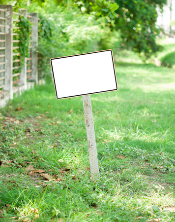 advertising signs: Sign on grass whith isolated space for caption