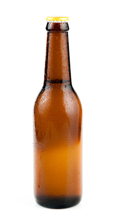 dew cap: Bottle of beer with drops isolated on white background
