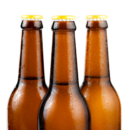 dewed: Bottle of beer with drops isolated on white background