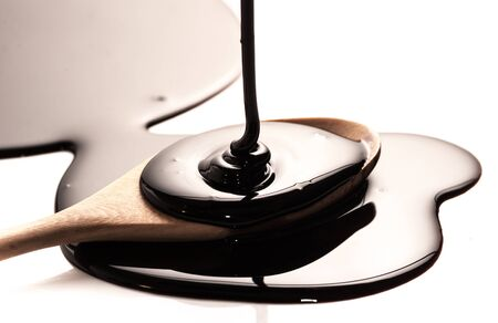 Chocolate flow close up with a spoon