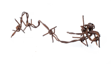 Rusted barbed wire isolated on white background Stock Photo