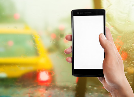 hand jam: Hand holding smart phone on traffic jam background. Stock Photo
