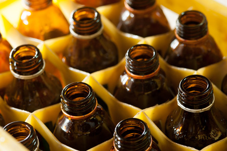 brown bottles: Empty brown bottles in a yellow crate
