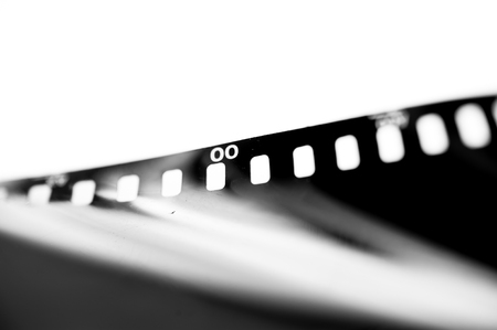 old movies: Close-up Film of a roll 35 mm photographic film,Selective focus with shallow depth of field.