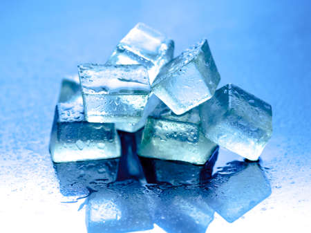 refrigerate: Ice cubes on reflected glass background,blue background