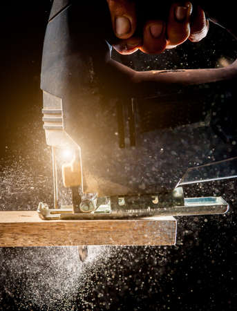 action shot: Close up electric jigsaw cutting a piece of wood,action shot Stock Photo