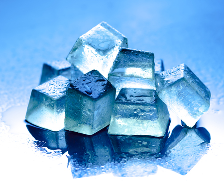 clean water: Ice cubes on reflected glass background,blue background