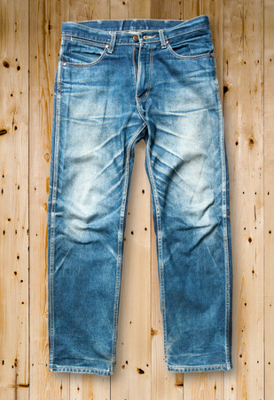 trouser: Blue jeans trouser on wood background