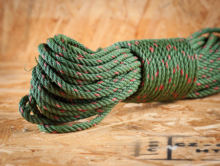 climbing cable: Green rope on wood Stock Photo