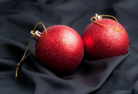 black silk: Red christmas ball on a black silk cloth