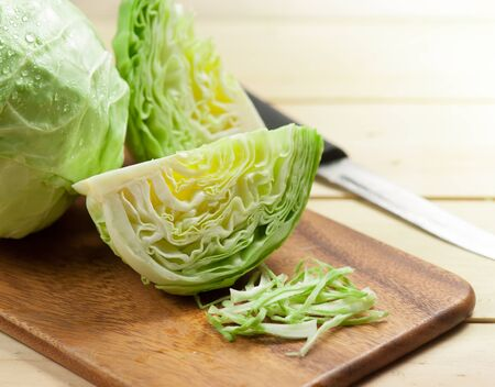 cabbage and cutted cabbage on wooden Archivio Fotografico