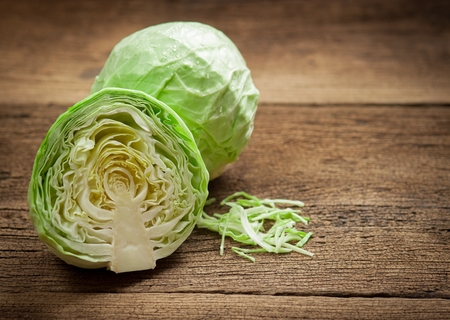 cabbage and cutted cabbage on wooden Zdjęcie Seryjne